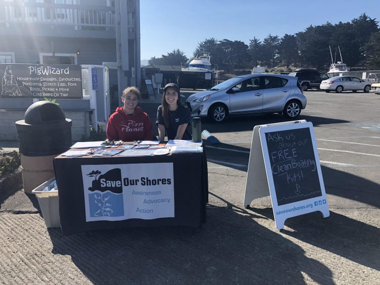 Sanctuary Steward Haley Canales with high school volunteer Nicole conducting boater outreach at Breakwater Cove, Monterey.