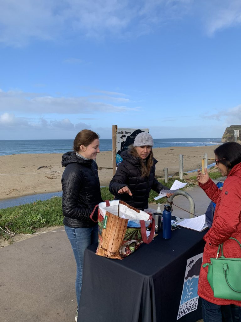 Sanctuary Stewards Sophia and Grace prepping folks for a cleanup at Scott Creek Beach