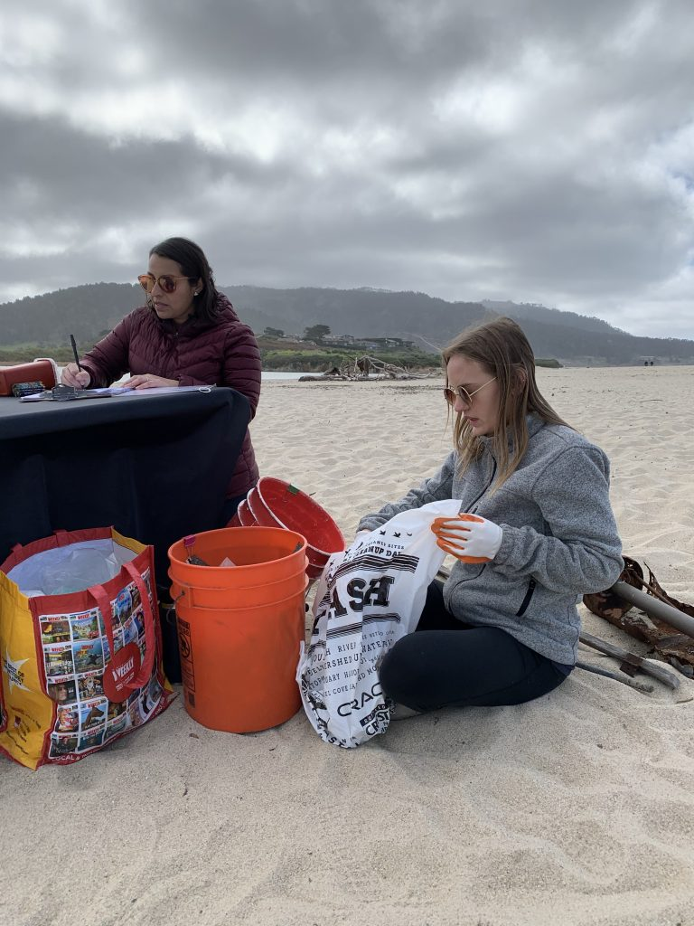 Stewards Claudia and Holly conducting a Brand Audit after a cleanup at Carmel River State Beach